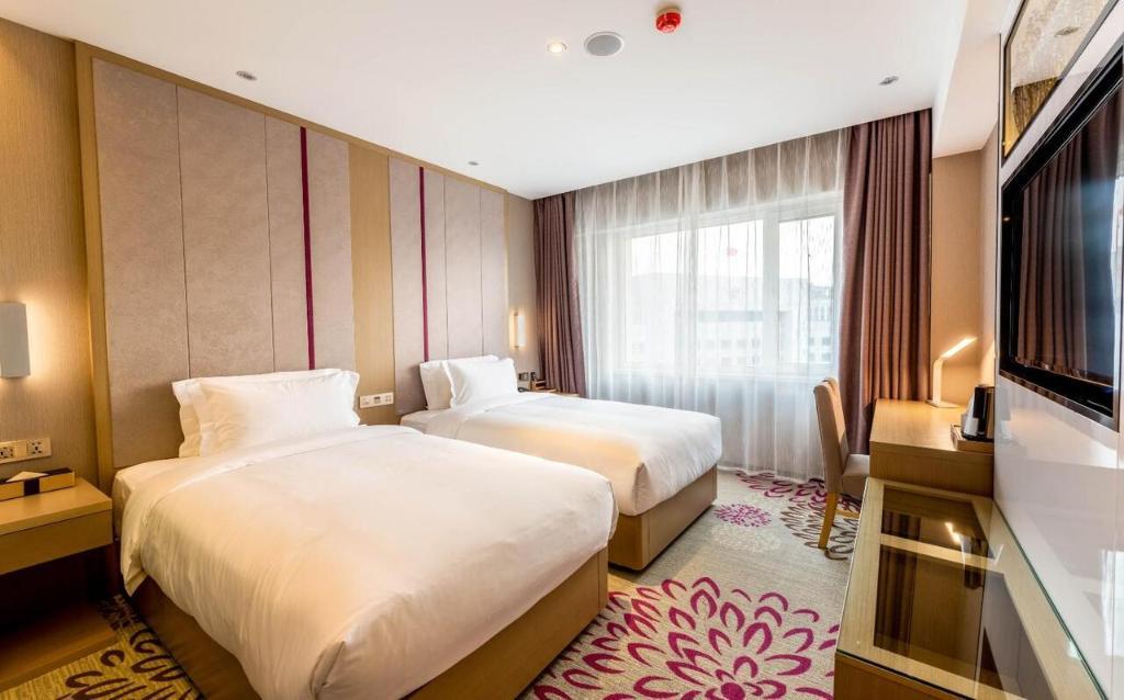 麗枫酒店·沈阳北站市府广场店客房内的一张或多张床位