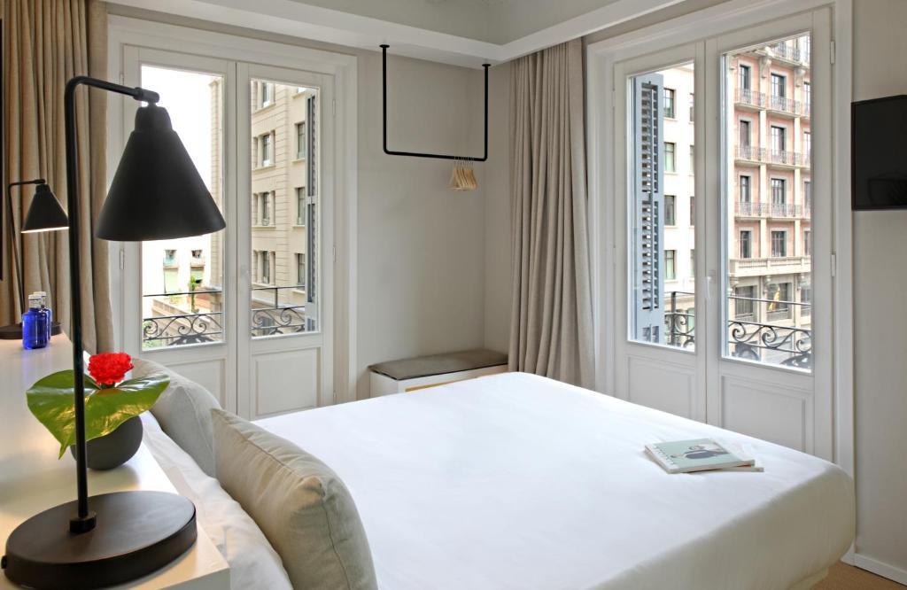 姆兹卡泰多拉尔精品旅馆客房内的一张或多张床位