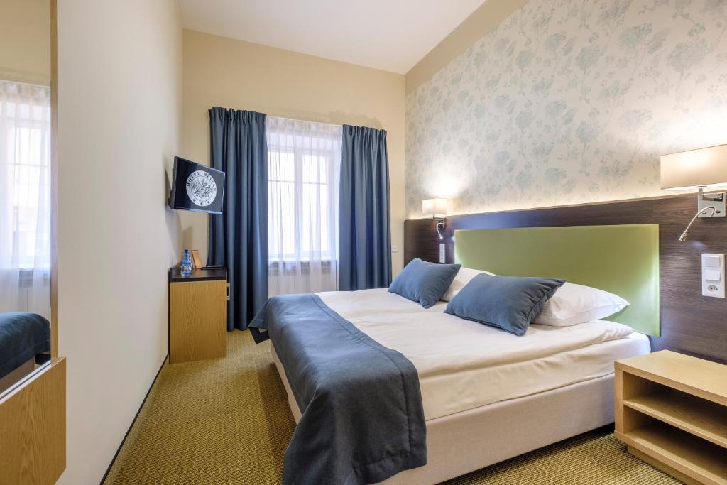 雷坦酒店客房内的一张或多张床位