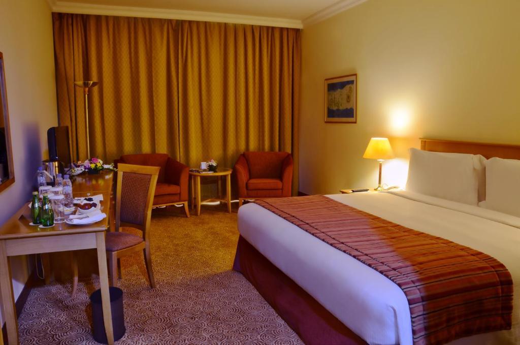 沙迦瑞士贝尔酒店客房内的一张或多张床位