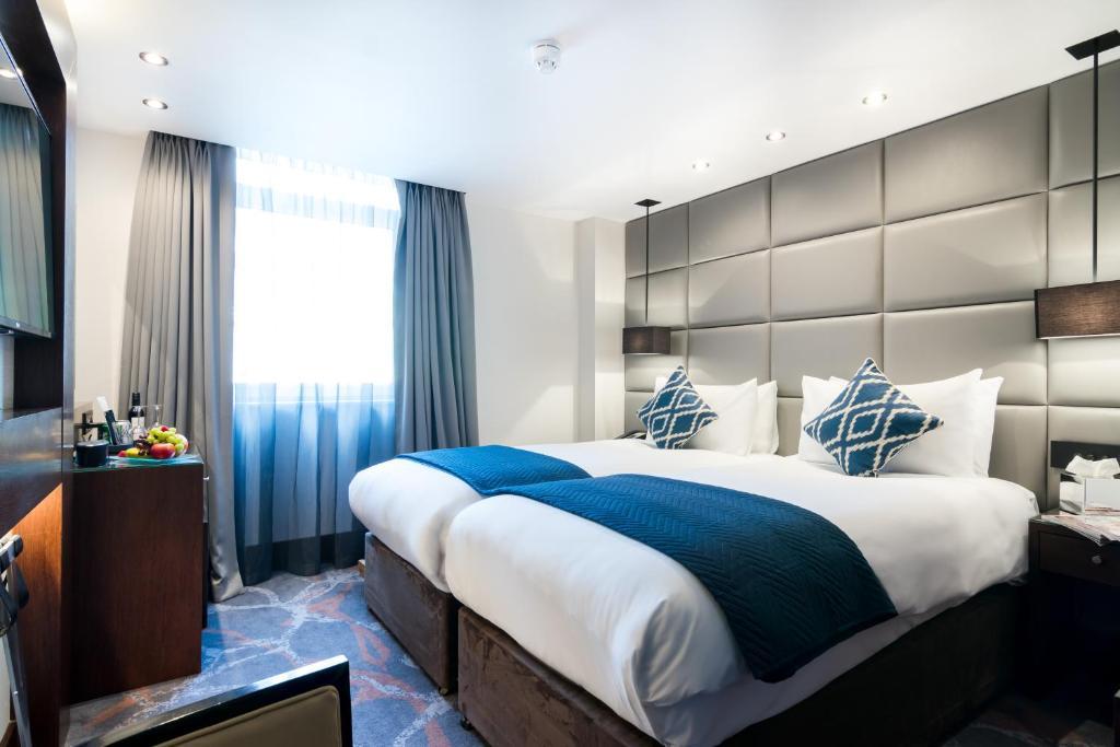 沙夫茨伯里伦敦尊贵帕丁顿酒店客房内的一张或多张床位