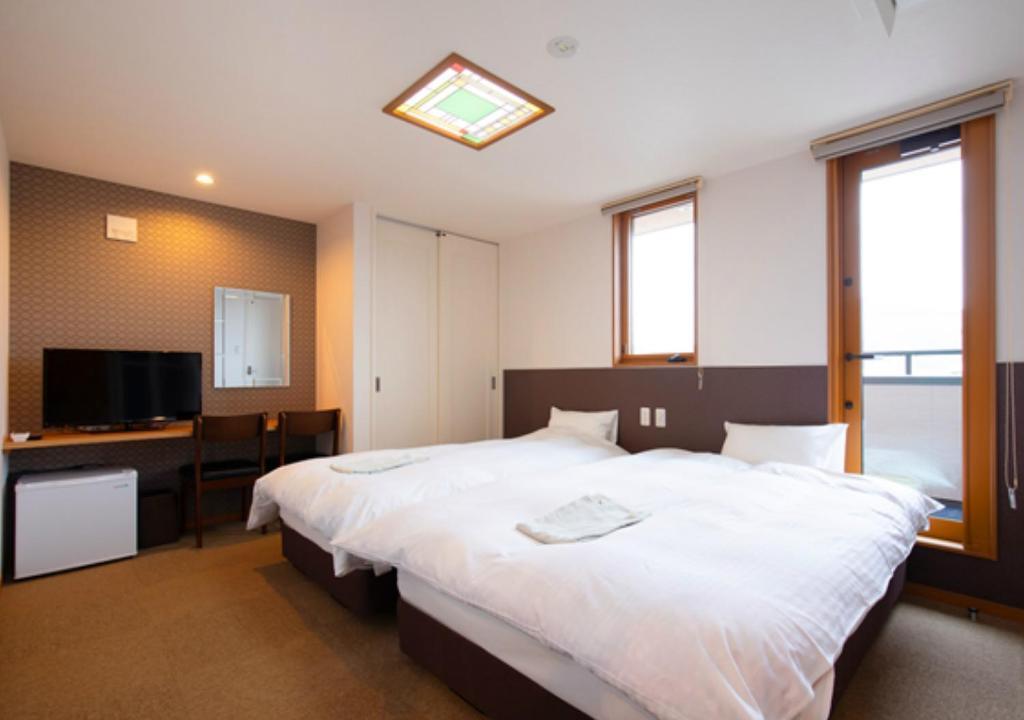 Wright Style客房内的一张或多张床位