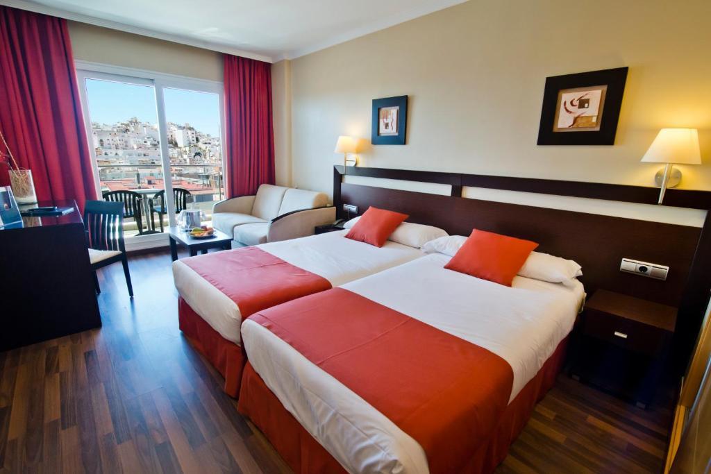 阿尔姆尼卡海湾酒店客房内的一张或多张床位