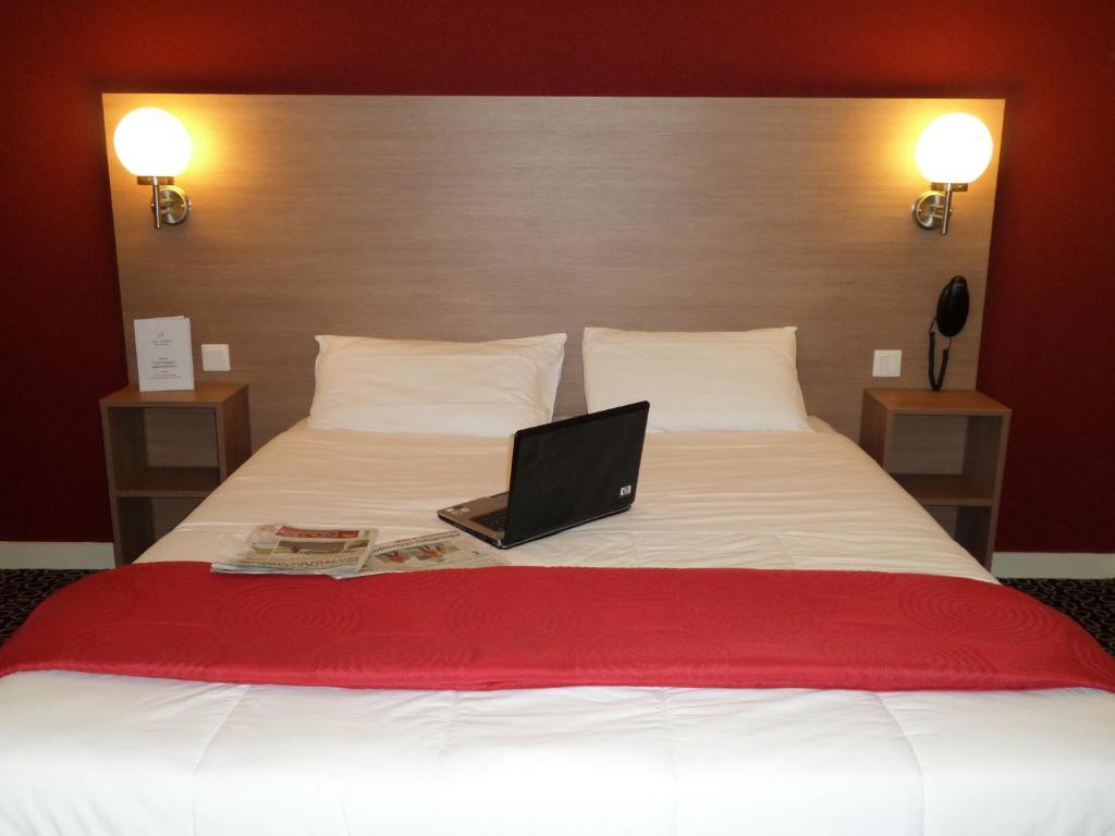 Hotel La Luna客房内的一张或多张床位