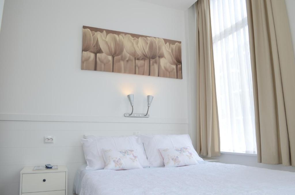 维特胡斯席凡宁根酒店客房内的一张或多张床位