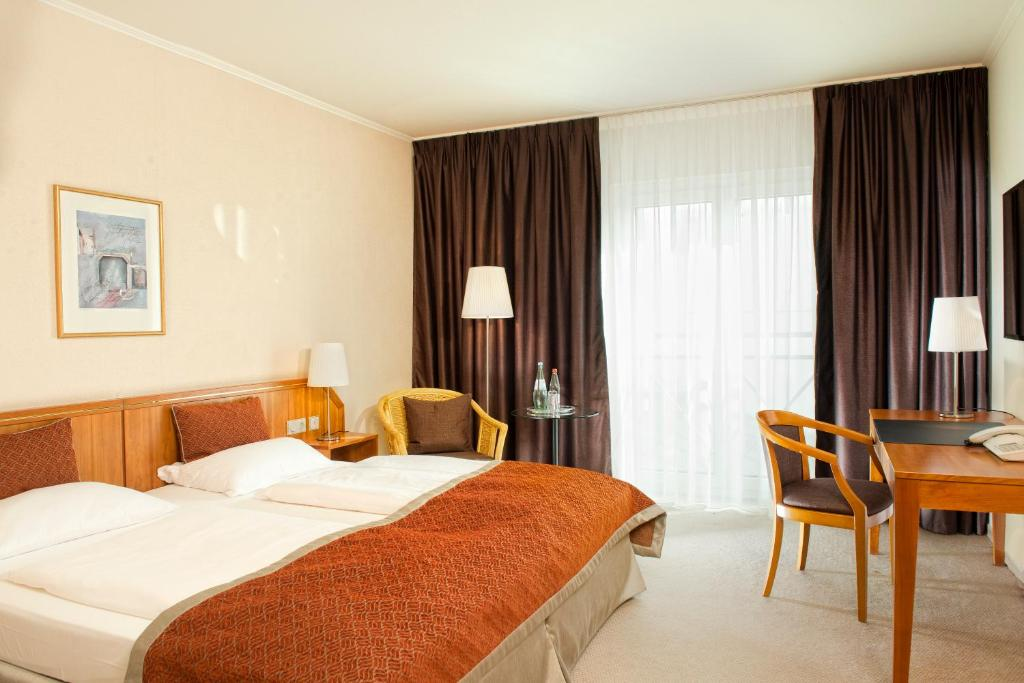 温德姆汉诺威庭酒店客房内的一张或多张床位