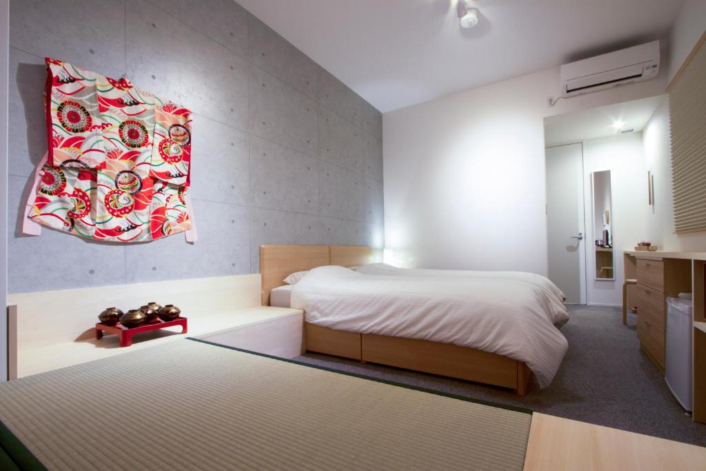 京都东山酒店客房内的一张或多张床位
