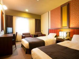 秋田川反珍珠城市饭店客房内的一张或多张床位