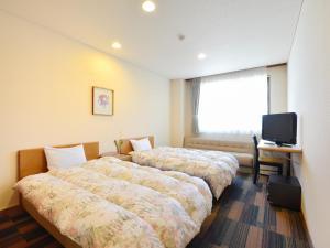 能登路康乐饭店客房内的一张或多张床位