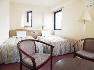 公园大道酒店客房内的一张或多张床位