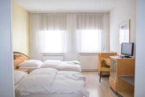 托库斯旅馆客房内的一张或多张床位