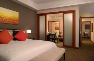 南京仁恒辉盛阁国际公寓客房内的一张或多张床位