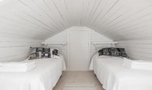 Pikisaari Guesthouse客房内的一张或多张床位