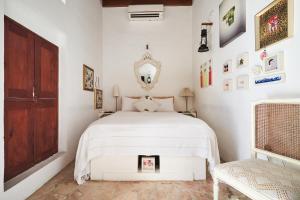 XVA艺术酒店客房内的一张或多张床位