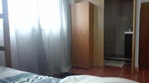 VistaFreita- Rooms & Suites客房内的一张或多张床位