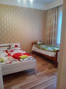 Aisa 18 Apartment客房内的一张或多张床位