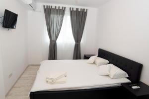 Denisa Apartamente客房内的一张或多张床位