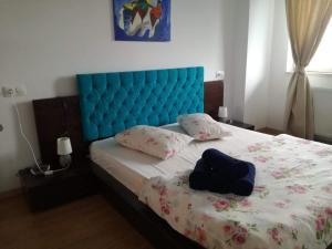 Apartament lux Viva City客房内的一张或多张床位