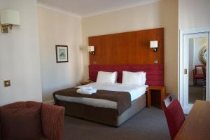 阿可仑皇家剑桥酒店客房内的一张或多张床位