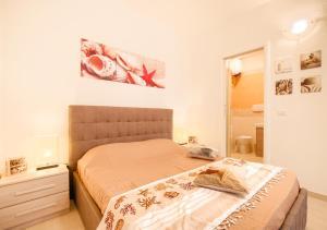 Appartamento con Spiaggia Privata Wi-fi Parking客房内的一张或多张床位