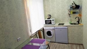 "Квартира-студия ""Атмосфера""的厨房或小厨房"