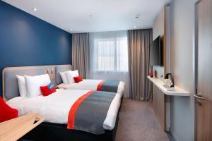 智选假日酒店 - 伦敦希思罗机场第四航站楼店客房内的一张或多张床位