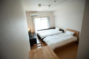 京都乌丸尾池瑞杰斯酒店客房内的一张或多张床位