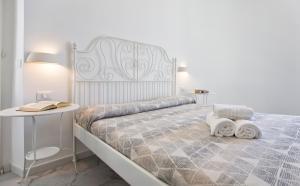 Ciutat Alghero客房内的一张或多张床位