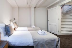 乔丹北区市场公寓酒店客房内的一张或多张床位