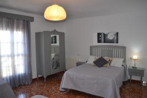 Casa Reyes catolicos客房内的一张或多张床位