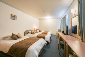 宫平酒店客房内的一张或多张床位