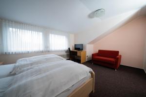 Hotel Emshof客房内的一张或多张床位
