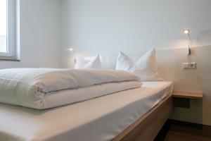 a2 HOTELS Denkendorf - Airport & Messe客房内的一张或多张床位