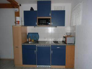 安德尔奎勒度假屋的厨房或小厨房