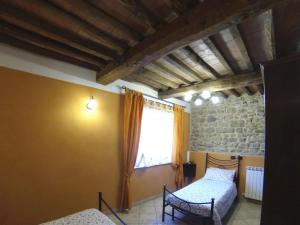 特吉利奥乡村民宿客房内的一张或多张床位