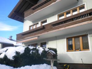 冬天的Ferienwohnung im Gästehaus Nussbaumer