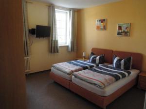 多明帕塔霍旅馆客房内的一张或多张床位