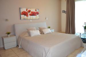 玛丽安娜酒店式公寓 客房内的一张或多张床位
