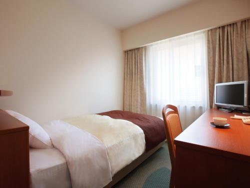 盛冈珍珠城市饭店客房内的一张或多张床位