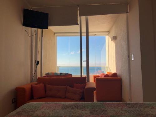 Departamento Costa Mansa, vista al mar的休息区