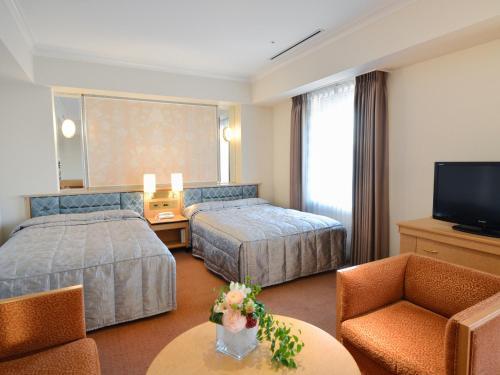 神户皇冠饭店客房内的一张或多张床位