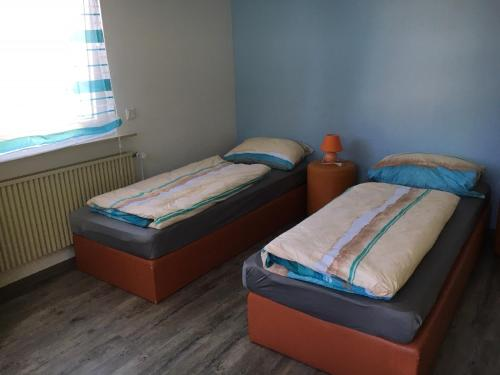 Ferienwohnung Pfeifer客房内的一张或多张床位