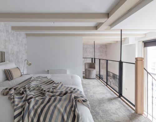 维滕贝格公寓式酒店客房内的一张或多张床位
