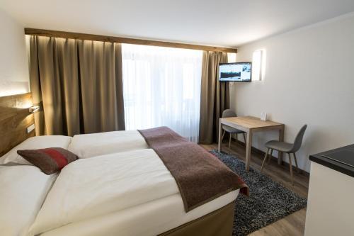 B-Inn Apartments Zermatt客房内的一张或多张床位
