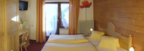 阿尔盆霍夫斯古瓦伊格酒店客房内的一张或多张床位