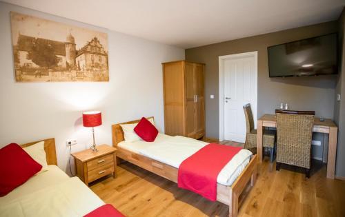Schloss Buchenau客房内的一张或多张床位