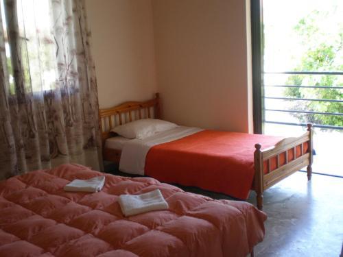 奥林匹克村一室公寓式酒店客房内的一张或多张床位