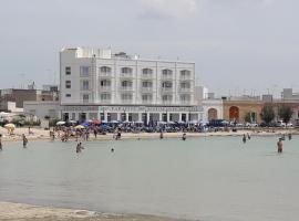 Grand Hotel Paradise, 切萨雷奥港
