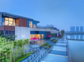 无锡玖树云林人文旅店,位于无锡苏南硕放国际机场 - WUX附近的酒店