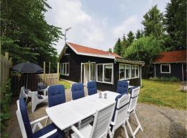 Four-Bedroom Holiday Home in Holbak